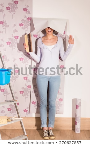 Decorator with wallpaper and a brush Stock photo © photography33