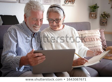 senior couple with a laptop stock photo © photography33