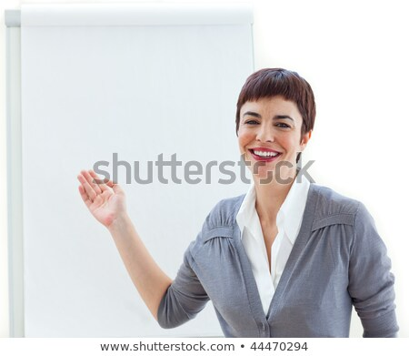Assertive young businesswoman ponting at a board  Stock photo © wavebreak_media