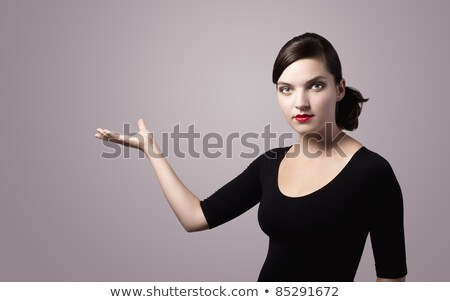 woman presenting something imaginary vintage colors stock photo © ra2studio