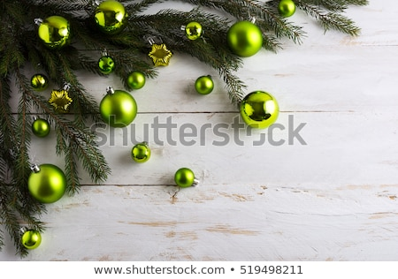 Christmas Ball On The Green Branch Photo stock © TasiPas