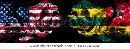 Football in flames with flag of togo Stock photo © MikhailMishchenko