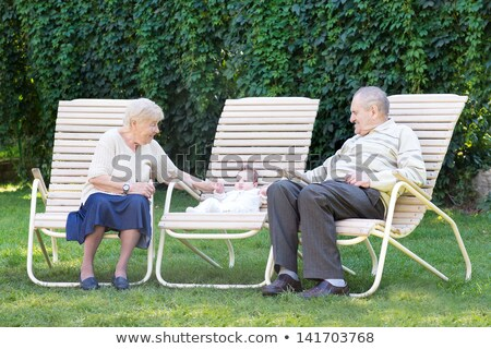 grandparents relaxing in the garden stock photo © is2