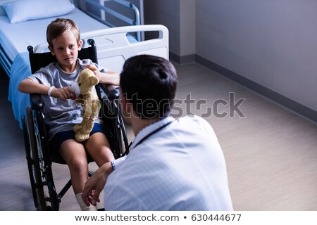 Doctor interacting with nurse in ward Stock photo © wavebreak_media