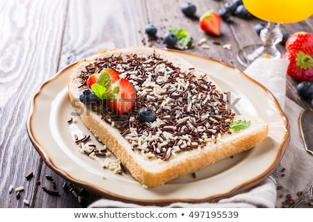 Slice of bread with hagelslag chocolate sprinkles Stock photo © Melnyk