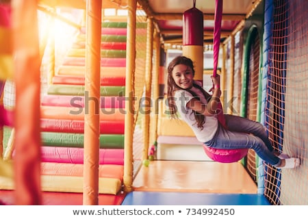 Many kids in amusement park Stock photo © colematt