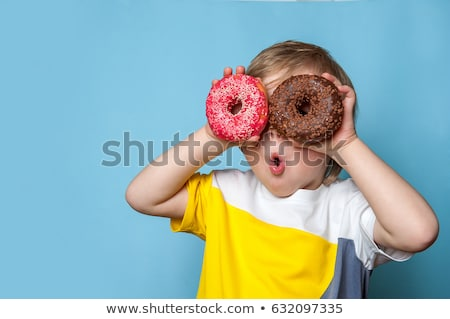 Funny boy with donut. child is having fun with doughnut. Tasty food for kids. Happy time outdoor wit Stock photo © galitskaya