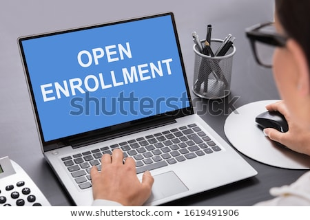 Person Working On Laptop With Open Enrollment Text Stock photo © AndreyPopov