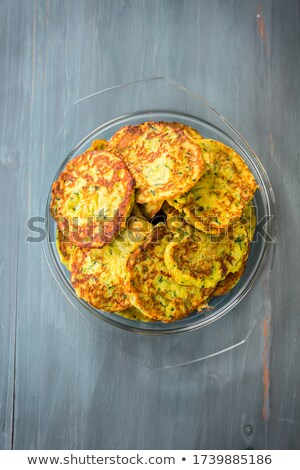 Low carb zucchini pancakes with curry and herbs Stock photo © brebca