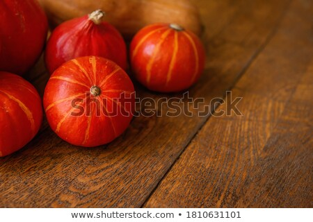 Fresh pumpkins on wooden floor with copy space Stock photo © dashapetrenko