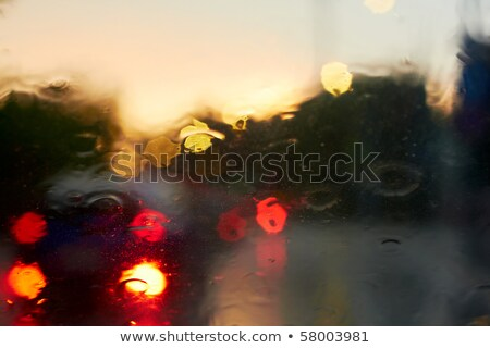 Rain drops with bokeh effect in provincial town at sunset. Stock photo © pashabo