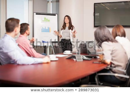 brunette giving a presentation stock photo © photography33