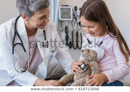 Young auscultating senior woman Stock photo © photography33