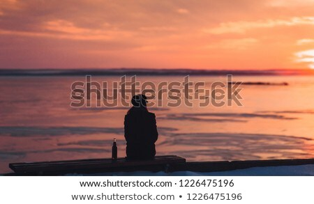 girl drinking a cold drink admiring the sea views stock photo © oleksandro