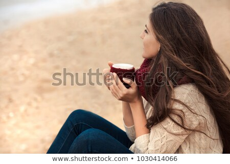beautiful young woman with a drink by the sea stock photo © dotshock