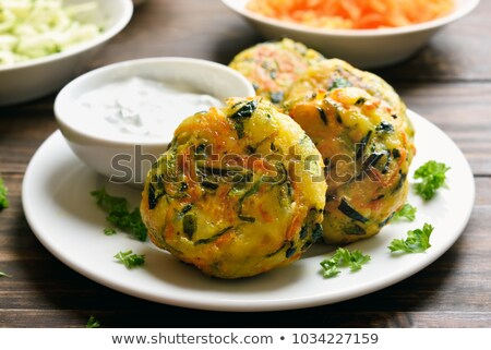 Vegetable fritters with carrots and zucchini Stock photo © vlad_star