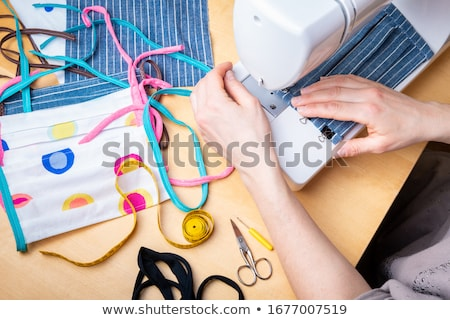 Woman sewing Stock photo © fuzzbones0