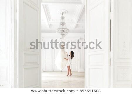 przewiewny · młoda · dziewczyna · biały · ubrania · stwarzające · studio - zdjęcia stock © elnur