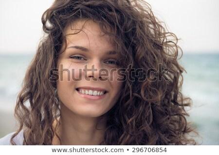 Quadro sorridente casual mulher cabelos cacheados Foto stock © feedough