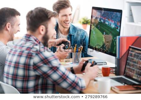 Imprenditore giocare computer giochi lavoro ufficio Foto d'archivio © Elnur