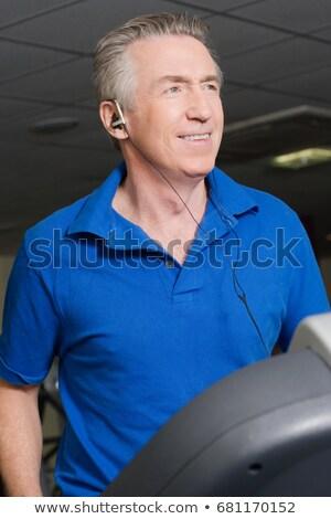 зрелый человек музыку мужчины прослушивании Сток-фото © IS2