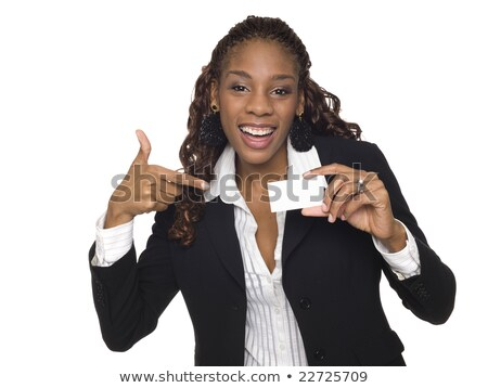 Studio shot of cheerful African American woman grins happily, keeps palm raised over copy space, pre Stock photo © vkstudio