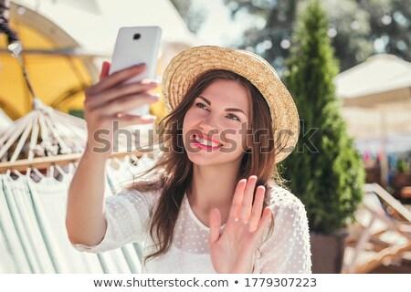 portrait · souriant · entrepreneur · coup · de · téléphone · lecture - photo stock © photography33