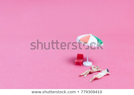 colorfull miniature toys in sand on beach Stock photo © juniart