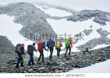 Group of hikers climbing hillside Stock photo © photography33