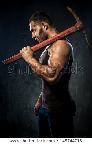 Young worker with a pickaxe Stock photo © photography33