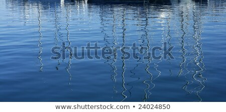 Boats abstract reflexion over blue water Stock photo © lunamarina