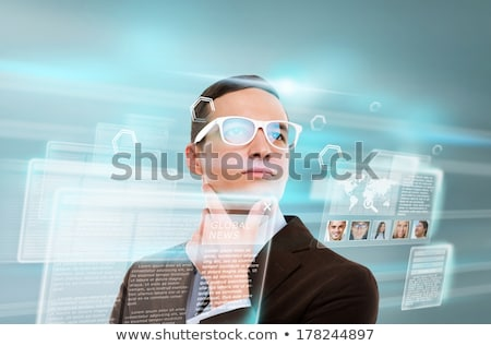 Handsome businesswoman against hightech background Stock photo © HASLOO