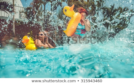 pin up girl jumping in the swimming pool stock photo © nejron