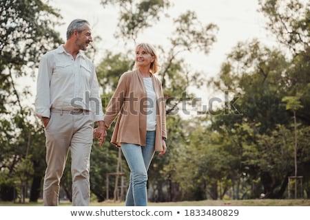 smiling couple walking outdoors stock photo © dolgachov