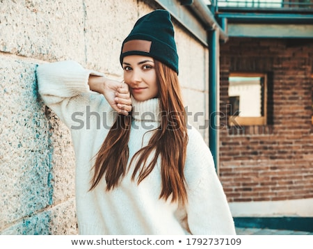 Fashion portrait of young woman near wall Stock photo © dariazu