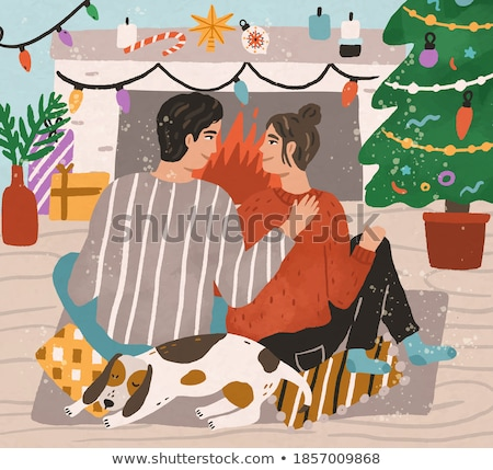 happy couple with dog enjoying winter evening stock photo © dariazu