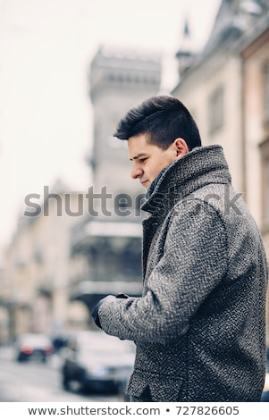 Close up of modern stylish gloves weared on handsome businessman  Stock photo © deandrobot