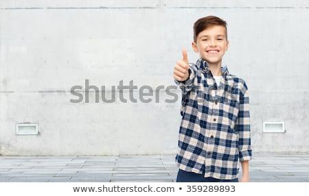 Uśmiechnięty chłopca shirt dżinsy mężczyzna Zdjęcia stock © dolgachov