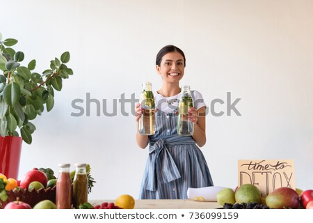 Stock photo: smiling woman with time to detox card