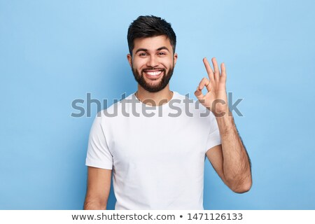 Close up portrait of handsome man being contented and happy whil Stock photo © deandrobot