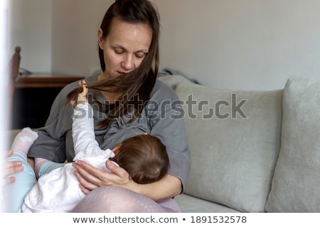 Brunette Young Mother Feed her Newborn Baby Breast Stock photo © robuart