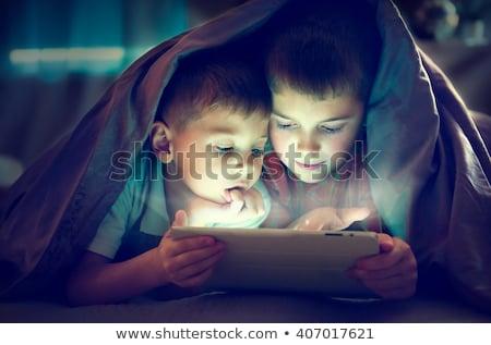 cute · fratelli · tablet · letto · home · felice - foto d'archivio © dolgachov