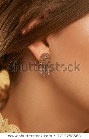 close up of woman with earring and pendant Stock photo © dolgachov