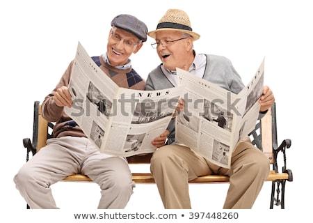 Nyugodt ülő férfi olvas újság fehér Stock fotó © feedough