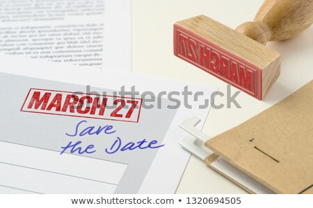 A red stamp on a document - March 27 Stock photo © Zerbor