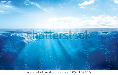 water wave and bubbles with sun rays background Foto d'archivio © SArts
