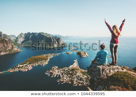 couple family traveling together on cliff edge in norway man and woman lifestyle concept summer vaca stock photo © elenabatkova