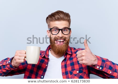 man in glasses with coffee showing thumbs up stock photo © dolgachov