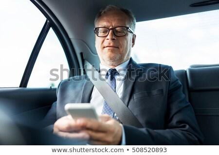 Idős üzletember sms chat okostelefon autó szállítás Stock fotó © dolgachov