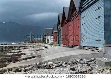 Karanlık bulutlar manzara arka plan tekne taş Stok fotoğraf © teusrenes